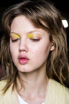 yellow eyelids.