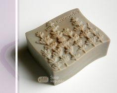 Item No. S-102 / Lavender Silicone Soap Mold    Size(inch):2 5/8 * 2 1/4 * 1 1/8(H)  Weight(oz):3.9oz(CP) Size(cm):6.8 x 5.8 x 3cm(H)