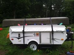 Use pool noodles and straps to assist in hauling your canoe/kayak on the top of your pop up camper.