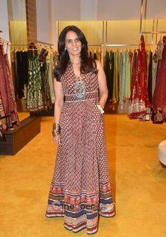 Indian fashion designer Anita Dongre in a maxi-dress and chunky tribal necklace