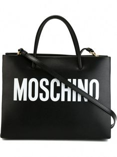 Black and white leather logo print square tote from Moschino featuring round top handles, an open top design, an internal zipped pocket, a detachable shoulder strap and gold-tone hardware. leather Made in Italy Tote Bags, Tote Purse, Tote Handbags, Purses And Handbags, Black Tote Bag, Black Handbags, Luxury Handbags, Designer Handbags, Handbags Online