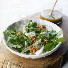 Arugula-Endive Salad with Honeyed Pine Nuts | This salad reinvents the classic combination of blue cheese and honey with crumbled Maytag blue and a crunchy, brittle-like garnish made from honey and pine nuts. Pine nuts have a subtle flavor that goes especially well with milder honeys, but other nuts, like pecans and walnuts, work nicely here, too.