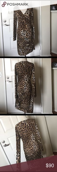 Michael Kors leopard zipper dress Perfect for transitioning from winter to spring, this timeless wardrobe staple was made to last! In excellent used condition with no signs of wear. Tag has numbers written on it. Michael Kors Dresses Asymmetrical