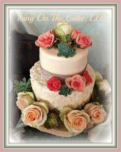 Simple, rustic wedding cake.   www.facebook.com/icingonthecake1