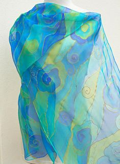 Long Blue chiffon silk scarf Handpainted on sheer transparent pure silk in azure , turquoise , royal blue , lime green , gold . Hand painted unique silk wrap . I painted this lovely scarf on a lightweight transparent chiffon : muslin silk . It is the most ethereal light silk ever woven and it
