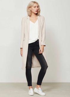 Effortless and versatile is this oyster longline blazer with a skinny self fabric belt. Perfect for teaming over grey skinnies or a printed dress for the epitome of relaxed glamour. Model is 5'10in and wears a UK size 10. The length from the side neck point to hem is 106cm/42in. Please note this garment is dry-clean only.