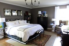 bedroom-decorating-painted-charcoal-gray-walls-white-bedding-black-dresser-decorating-ideas