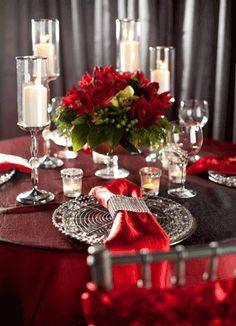 Add a touch of drama to your wedding with these red damask linens complete with candles and roses. Romantic and dramatic.