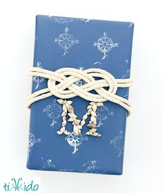 Nautical Knot Gift Wrapping Ideas: http://www.completely-coastal.com/2014/11/nautical-knot-gift-wrapping.html