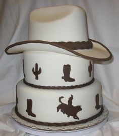 Hat is full size and made of gumpaste The bull rider I made a template for and cut out of fondant using my xacto knife