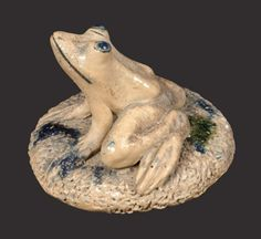 "Sold $ 5,000 Rare Cobalt-Decorated Stoneware Frog Paperweight, Singed ""Anna Pottery / 1887,"" Wallace and Cornwall Kirkpatrick, Anna, IL, molded figure of a frog with incised details to face and feet, seated atop a heavily-incised, circular base. Eyes, mouth, and base, accented with cobalt slip. Underside incised ""Anna Pottery / 1887"". Excellent, cream-colored clay ground. Frog features well-detailed, bulging eyes. The distinctive Anna frog form is typically found adorning clamshell-based…"