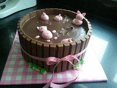 Three little piggies in a bucket of chocolate.