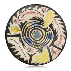 PROPERTY FROM A PRIVATE NEW YORK COLLECTIONPablo Picasso (1881-1973) Motifs no. 17 (A.R. 462)stamped and numbered 'N.17 / Edition Picasso / 86/150 / Madoura' (underneath)white earthenware ceramic plate with coloured engobe and glazeDiameter: 10 in. (25.4 cm.)Conceived in 1963 and executed in a numbered edition of 150