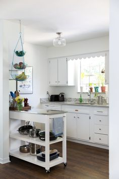 The kitchen is simple and clean. The turquoise fruit holder was found on Amazon.