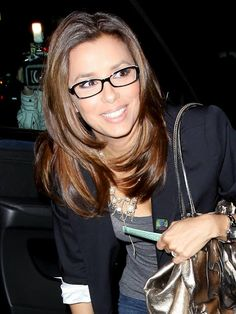 I like Eva Longoria's glasses in this picture. I have to wear glasses for everything but reading. The ones I have now are designed to sort of blend into my face..I'm starting to think intentionally obvious frames like these are more flattering to wear.