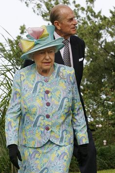 Queen Elizabeth, love the hat, colours and massive bow.let's not forget The Queen Mothers Palm Leaf Brooch.