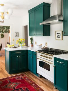 jewel tone cabinets with a white range