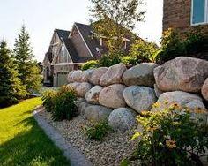 Bilderesultat for boulder retaining wall