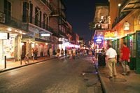 Bourbon Street is an almost legendary historic street in the French Quarter. It is best known for its many bars and clubs and it is constantly crowded with tourists, especially at night.