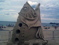 Pez_mecanico. Arena de playa.