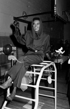 ELLE loves... this iconic black and white photograph of the one and only Grace Jones wearing an 80's power suit with leather gloves and heels.   Click through for more celebrity style inspiration.