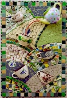 mosaic panel with tea pot and tea cups -- pc has sold, but how cool is this? Would be great with herbs planted in the cups.