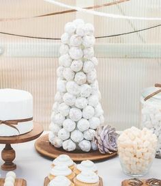 If you're afraid there won't be enough wedding cake for everyone, fear not, because there are a ton of delicious food table ideas out there, including this Powdered Doughnut Hole Croquembouche.