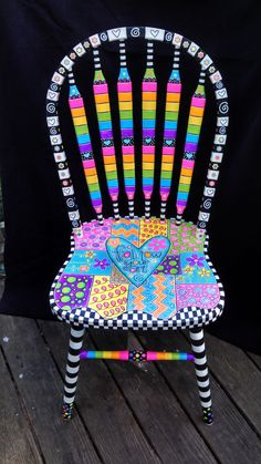 Brightly painted furniture...My Happy Chair makeover http://mysingingheartart.blogspot.com/2015/05/ugly-chair-makeoverfrom-ugly-to-happy.html #funkyfurniture