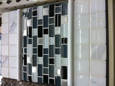 Melissa said she likes white/black/gray subway tile for backsplash in kitchen, I saw this at home depot