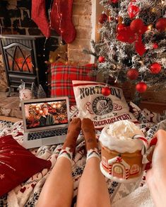 Love this look! The perfect cosy Christmas set up, complete with hot chocolate, fluffy throw, a roaring fire and of course a family favourite Christmas film!