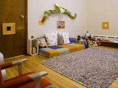 Montessori bedroom... I LOVE the dragon above the bed!