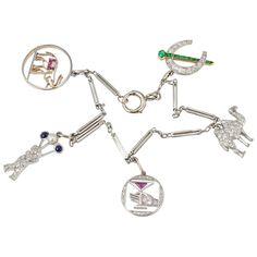 1930s Art Deco Diamond Platinum Charm Bracelet | From a unique collection of vintage charm bracelets at…