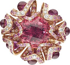 Ring in pink gold, rubies, pink sapphires, diamonds, drops of red tourmaline, set with a round faceted pink tourmaline. Chaumet.