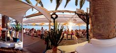 Cafe Mambo, Carrer de Vara del Rei - Sit on the rocky beach and soak up the sunset with a beer http://barchick.com/find-a-bar/ibiza/cafe-mambo