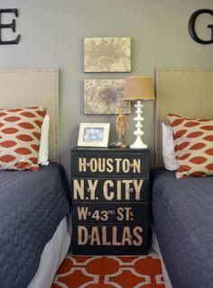 Boys bedroom. Tan. Blue. Orange. Navy. Street sign accent table between 2 beds.
