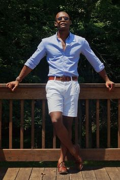 Amazing Holiday look with this Light Blue Shirt styled with White Shorts and a pair of Brown Leather Derby Shoes
