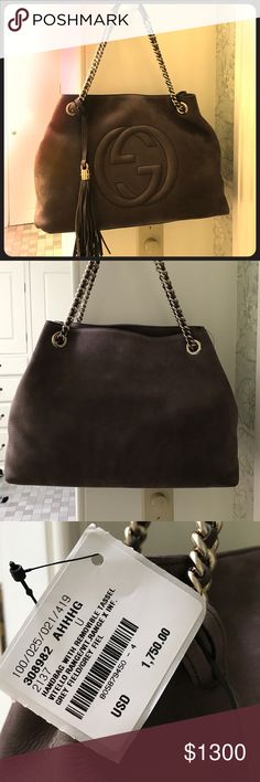 """Gucci hobo bag Authentic NEVER USED NEW WITH TAG Gucci suede hobo with chain link double handle 8"""" drop can slip to single handle 14.5"""" drop. Front logo and removable tassel. Measures 10x15.  Comes with dust bag and original Gucci shopping bag. Gucci Bags Hobos"""
