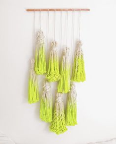 Macrame Tassel Wall Hanging by Tamara Maynes at The Six Week Boutique.   This upscale collectable is the follow up to my modern macrame owl and was inspired by my dip dyed tassel garland project from the DIY book 82 Modern Style Ideas.