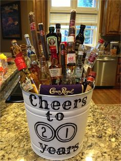 Liquor bouquet I made for my boyfriend's 21st!  -Hand Painted  -Mini Liquor Bottles  -Cigars  -Beef Jerky   -Alcoholic Chocolates   -Shot Glass