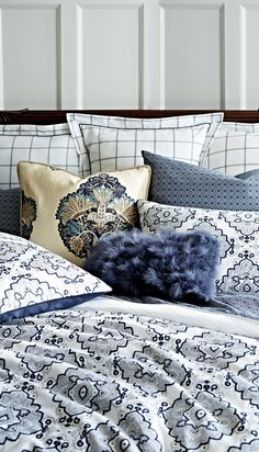 Haberdashery styling in indigo makes the Wilshire Bedding Collection a sartorial standout. From the duvet cover's diamond patterning to the ascot-inspired sheeting and windowpane plaid shams, Wilshire makes a dapper addition to any bedroom.