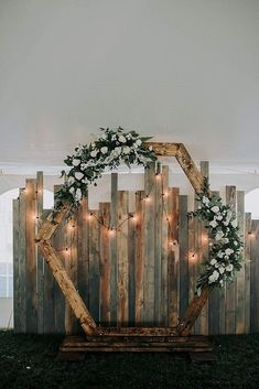 36 Rustic Wedding Decor For Country Ceremony rustic wedding d cor hexagon shaped backdrop with greenery roses and lightbulb dorothy renzi weddingforward wedding bride rusticwedding rusticweddingdecor Diy Rustic Decor, Rustic Theme, Country Decor, Rustic Design, Rustic Cake, Fall Wedding, Dream Wedding, Wedding Bride, Winter Wedding Arch