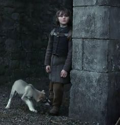 This photo of Bran makes me sad because I realized two things. 1) This was the last time he saw his father and 2) These were some of last moments that he had the use of his legs.  =(  //  Game of Thrones, Season One, Episode One