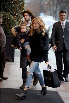 Sienna Miller Love the ankle length jeans ending just above the ankle boots.