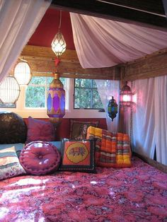 Boho design. Inviting bohemian pillows and quilt. Hanging lanterns complete this bohemian bedroom to rest and dream.