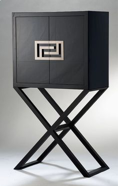 The Versace Cocktail Crystal Glass Storage Cabinet is structured with a strong wood essence base and then lacquered to finish in black shiny...
