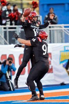San Diego State quarterback Quinn Kaehler (18) and tight end Robert Craighead, right, celebrate Kaehler's touchdown. (Otto Kitsinger/AP)