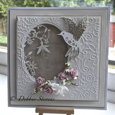Hi everyone, Today s card ingredients are... Spellbinders grand squares, spellbinders classic ovals large, the embossing folder is 8x8 and I think its by Tattered lace but i don't know what its ca...