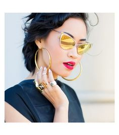 Nininguyen is wearing: Tom Ford sunglasses.  Tom Ford Cat-eye Flash Gold Sunglasses ($328)