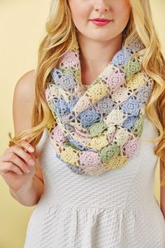 Simple pastel crochet cowls are a wardrobe staple. If you're trying to create a wardrobe capsule, this should make the cut