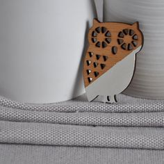 Origami_Brooch_Owl from ArtySmartyShop.com   This origami style brooch is made from wood and then carefully hand painted in pastel colors and finished with a durable varnish. There are also matching necklaces, to go with these brooches.  #artysmarty #handmadejewelry #fashionbloggers #styleinspiration #handmadejewelry